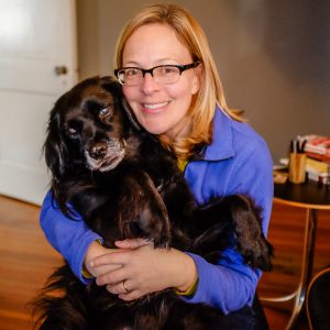 Wendy Rawlings with a black dog