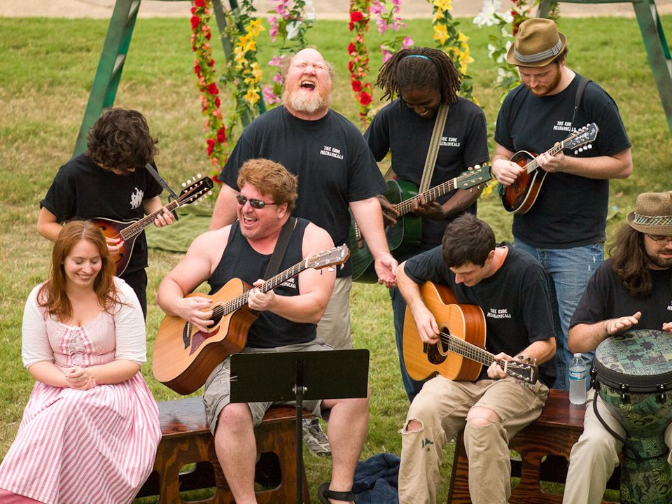 A group of musicians perform in a park