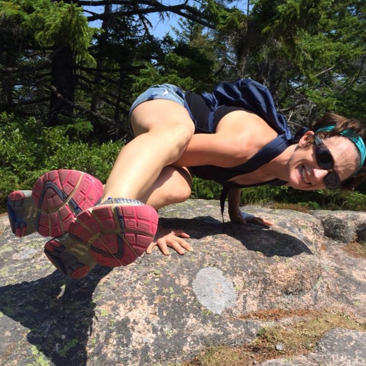 Bonnie Whitener doing a yoga pose on a rock